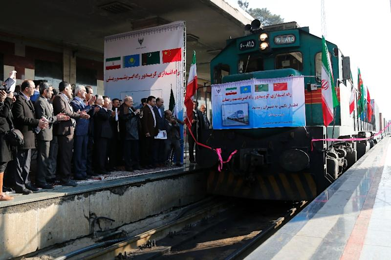 Iranian officials applaud on the platform as the first train connecting China and Iran arrives at Tehran Railway Station on February 15, 2016 (AFP Photo/)