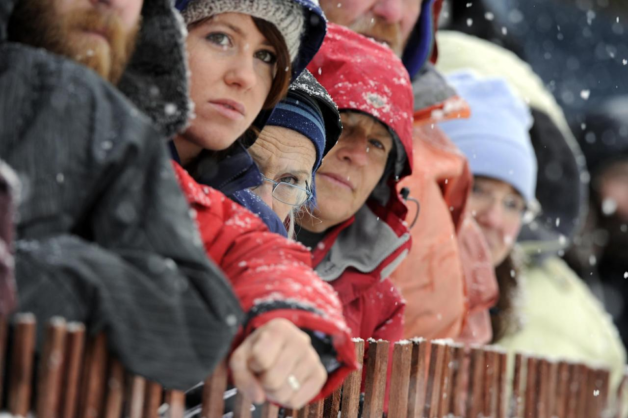 Fans watch along 4th Avenue during the ceremonial start of the Iditarod trail sled dog race, Saturday, March 3, 2012, in Anchorage, Alaska. (AP Photo/The Anchorage Daily News, Marc Lester)