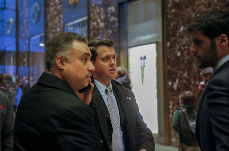FILE - In this Dec. 12, 2016 file photo, Los Angeles venture capitalist Imaad Zuberi, far left, arrives at Trump Tower in New York. Federal prosecutors in New York have informed Zuberi, a major donor to President Donald Trump's inaugural committee, that they intend to charge him with obstruction of justice and failing to register as a foreign agent. Attorneys for Zuberi filed papers late Thursday, Nov. 21, 2019, seeking a continuance of Zuberi's court proceedings in Los Angeles. (AP Photo/Kathy Willens, File)