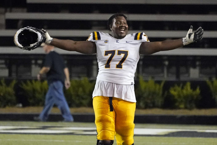 East Tennessee State offensive lineman Fred Norman Jr. celebrates after beating Vanderbilt in an NCAA college football game Saturday, Sept. 4, 2021, in Nashville, Tenn. (AP Photo/Mark Humphrey)