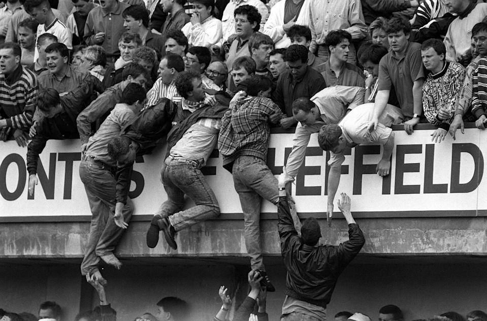 File photo dated 15/04/89 of Liverpool fans at Hillsborough, trying to escape severe overcrowding during the FA Cup semi-final football match between Liverpool and Nottingham Forest.