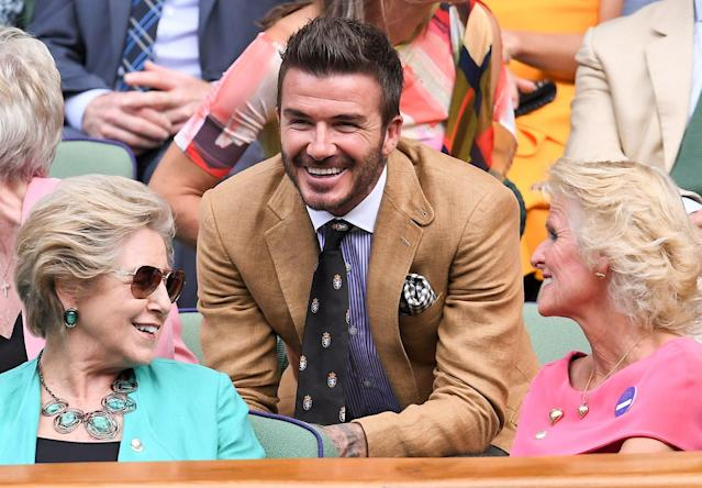 David Beckham is all smiles in the Royal Box on Centre Court on day 10 of the Wimbledon Tennis Championships in London on Thursday.