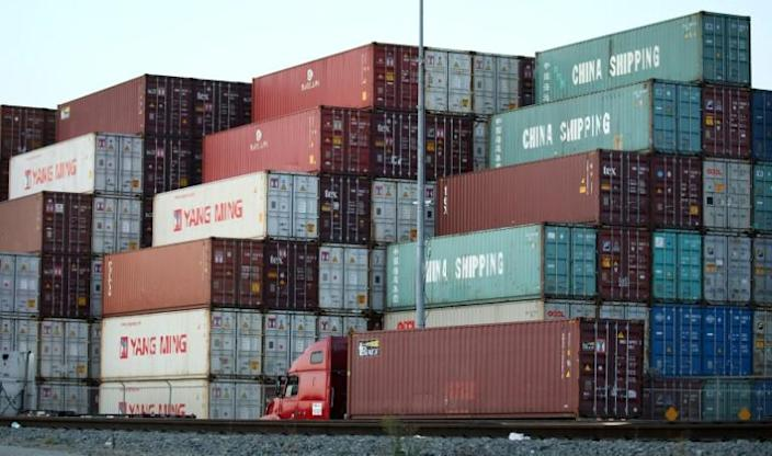 Shipping containers are stacked at the Port of Los Angeles in November 2019 -- under the trade deal, Beijing is to buy an additional $200 billion in American products (AFP Photo/MARIO TAMA)
