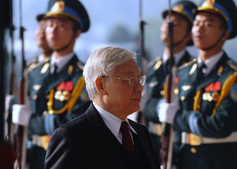 Vietnam Communist Party's Secretary General Nguyen Phu Trong (pictured centre) will meet US President Barack Obama at the White House next week (AFP Photo/Hoang Dinh Nam)