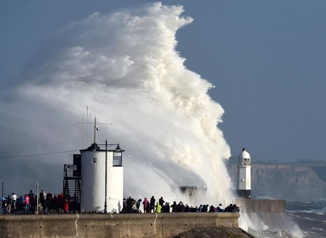 <p>Waves crash over the lighthouse as storm Ophelia passes Porthcawl, Wales, Britain, Oct.16, 2017. (Photo: Rebecca Naden/REuters) </p>