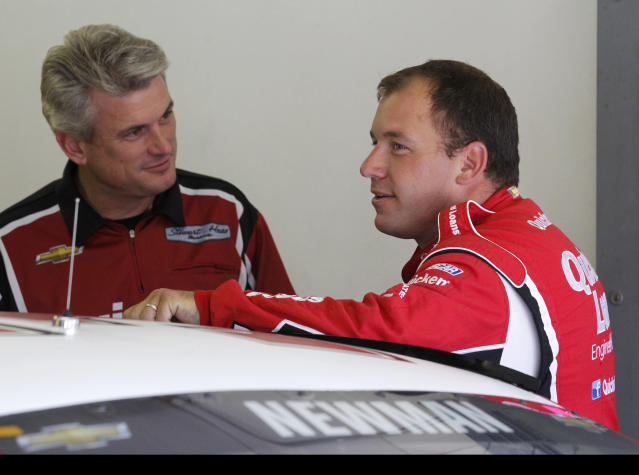 Ryan Newman, right, talks with a member of his crew during practice for Sunday's NASCAR Sprint Cup Series auto race at New Hampshire Motor Speedway, Friday, Sept. 20, 2013, in Loudon, N.H. (AP Photo/Mary Schwalm)