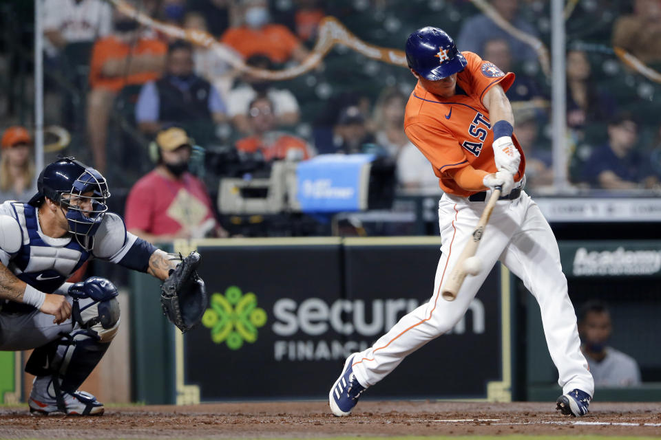 Houston Astros' Myles Straw connects for a RBI single in front of Detroit Tigers catcher Wilson Ramos during the second inning of a baseball game Tuesday, April 13, 2021, in Houston. (AP Photo/Michael Wyke)