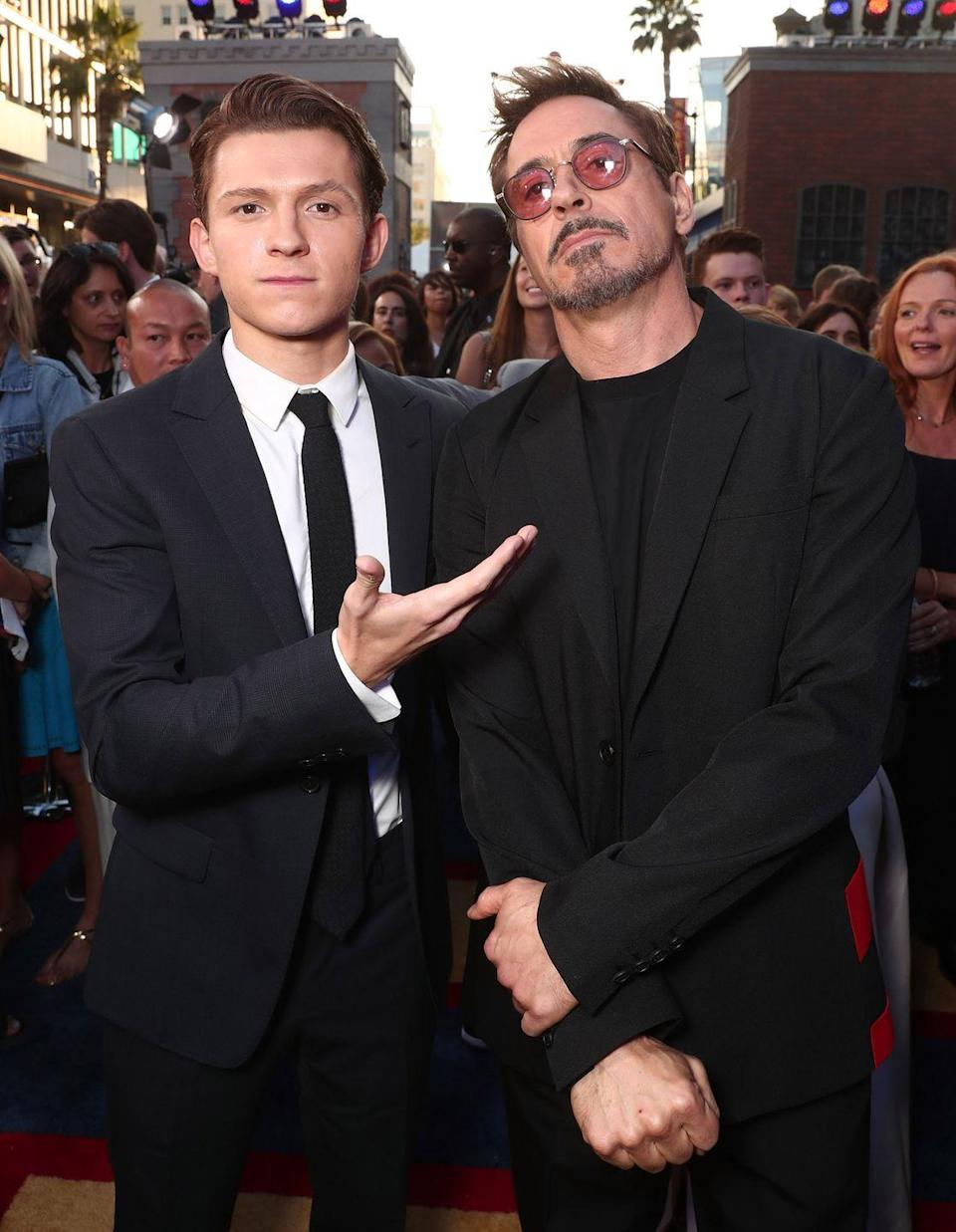 <p>Tom Holland and Robert Downey Jr. attend the premiere of <em>Spider-Man: Homecoming</em> at TCL Chinese Theatre on June 28, 2017 in Hollywood, California.</p>