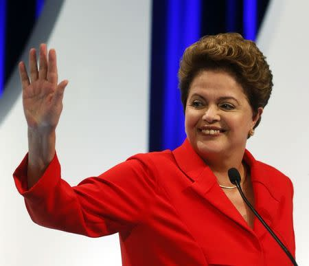 Presidential candidate Dilma Rousseff of Workers Party waves to the crowd before she takes part in a TV debate in Sao Paulo