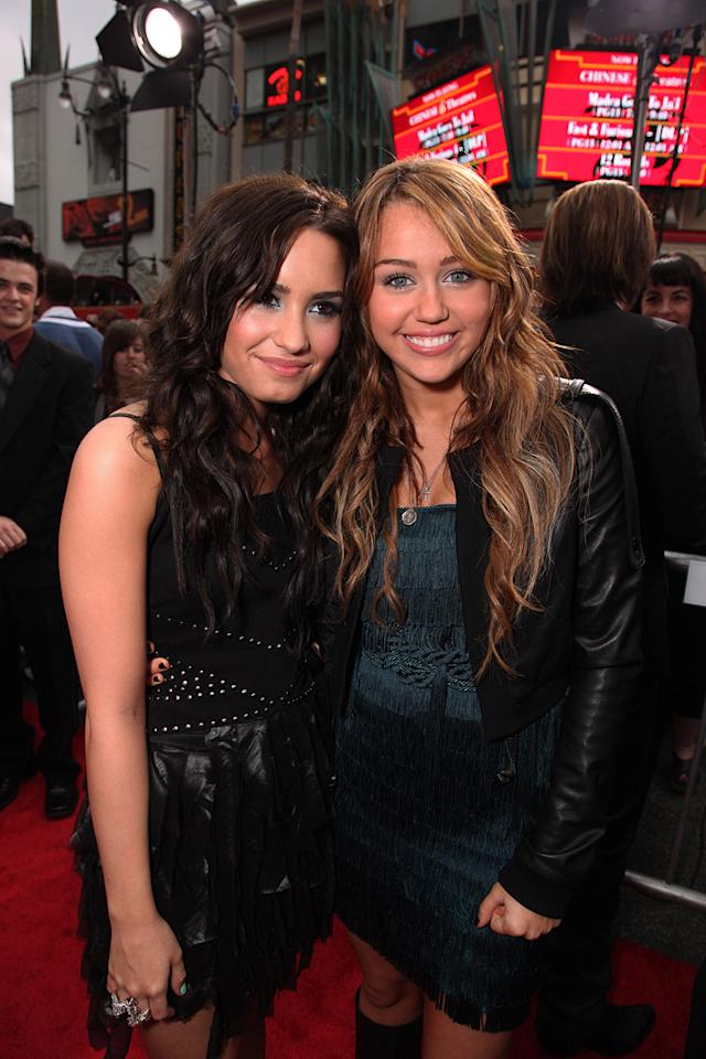 """<a href=""""http://movies.yahoo.com/movie/contributor/1808720472"""">Demi Lovato</a> and <a href=""""http://movies.yahoo.com/movie/contributor/1809849015"""">Miley Cyrus</a> at the Los Angeles premiere of <a href=""""http://movies.yahoo.com/movie/1810025272/info"""">Hannah Montana The Movie</a> - 04/02/2009"""