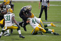 New Orleans Saints running back Latavius Murray (28) is hit by Green Bay Packers linebacker Ty Summers (44) in the first half of an NFL football game in New Orleans, Sunday, Sept. 27, 2020. (AP Photo/Butch Dill)