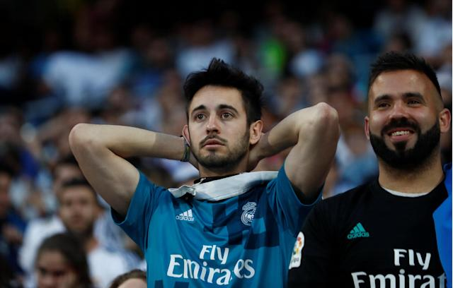 Soccer Football - Real Madrid fans watch the Champions League Final - Madrid, Spain - May 26, 2018 Real Madrid fan reacts while watching the match inside the Santiago Bernabeu REUTERS/Javier Barbancho