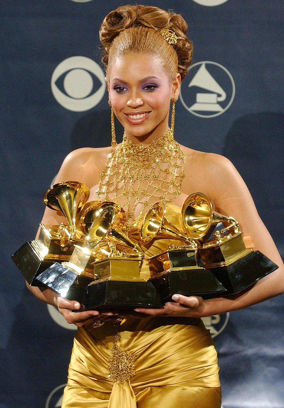 "<p>In 2004, Beyoncé embarked on her solo career, scoring six nominations. She went home with five Grammys, including awards for best contemporary R&B album for <em>Dangerously In Love</em>, best R&B song and best rap/sung collaboration for ""Crazy In Love,"" best R&B performance by a duo for ""The Closer I Get To You,"" and best female R&B vocal performance for ""Dangerously In Love 2."" </p> <p><strong>Beyoncé's Grammy Tally: </strong>8 </p>"