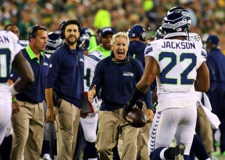 Seattle Seahawks head coach Pete Carroll reacts to a touchdown by running back Fred Jackson (22) against the Green Bay Packers during the second half at Lambeau Field. Sep 20, 2015; Green Bay, WI, USA. Ray Carlin-USA TODAY Sports