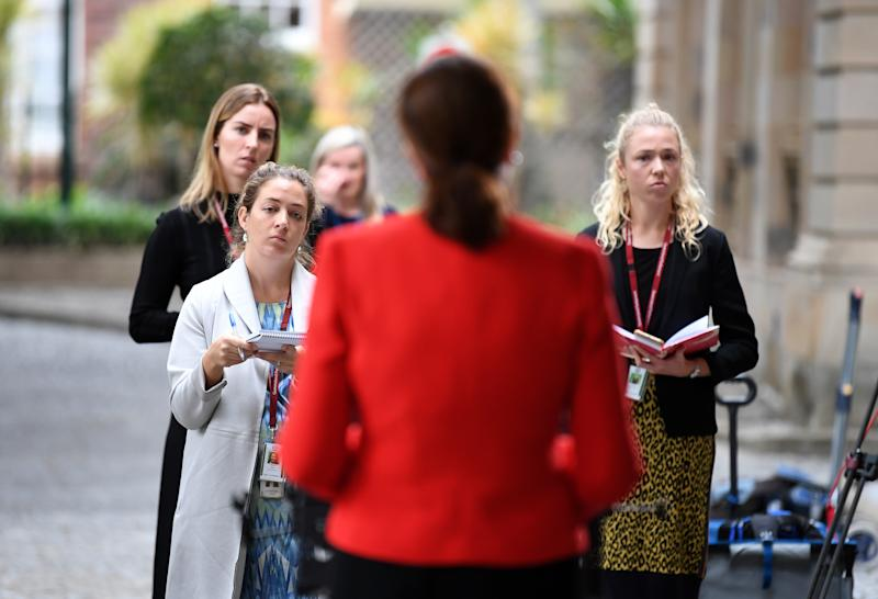 Reporters listen to Queensland Premier Annastacia Palaszczuk during a press conference at Parliament House in Brisbane. Source: AAP