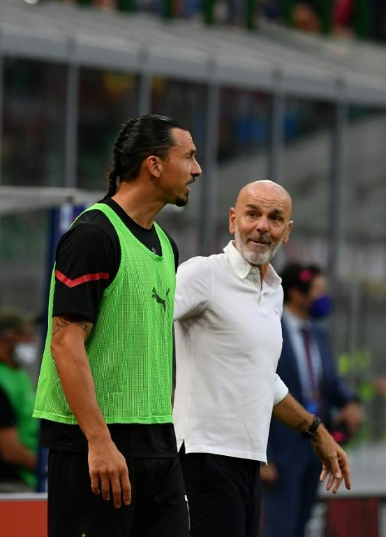 Stefano Pioli (R) led Milan to second in Serie A last season, their best finish since 2012 (AFP/Isabella BONOTTO)