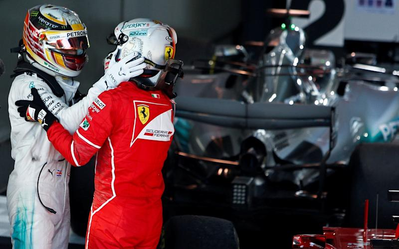 Lewis Hamilton and Sebastian Vettel congratulate each other - REUTERS