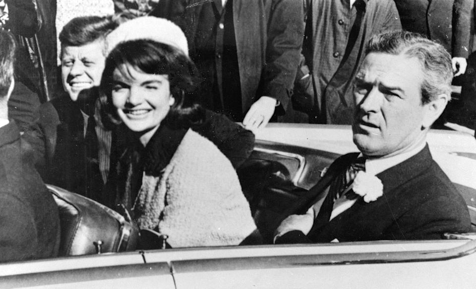 President John F. Kennedy and his wife, Jacqueline, smile as they drive with Texas Gov. John Connally of Texas from Love Field airport, in Dallas, on Nov. 22, 1963. (Photo: AP)