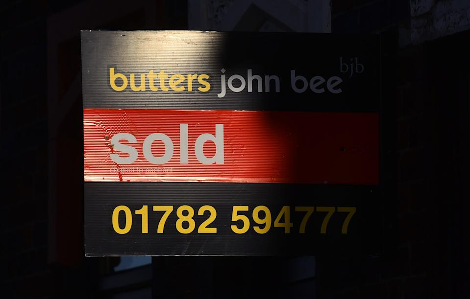 STOKE-ON-TRENT, ENGLAND - NOVEMBER 22: A sold Butter John Bee's estate agents placard on November 22, 2020 in Stoke-on-Trent, England. (Photo by Nathan Stirk/Getty Images)
