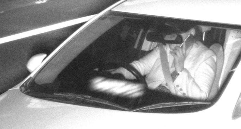 A driver photographed driving while speaking on a mobile phone.