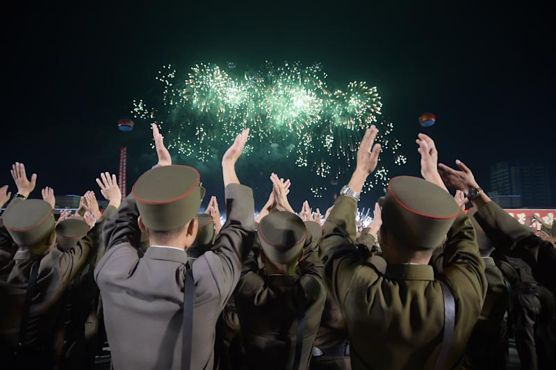 Korean People's Army soldiers cheer during a mass celebration in Pyongyang for scientists involved in developing North Korea's largest nuclear blast to date, Sept. 6, 2017