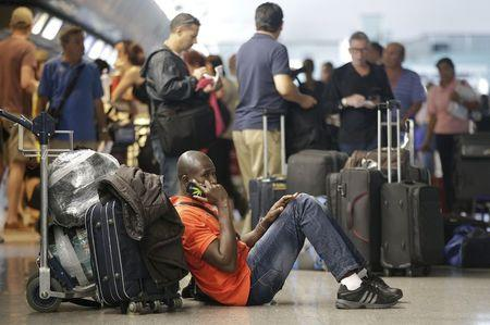 People wait at Fiumicino international airport in Rome, Italy, July 13, 2015. REUTERS/Max Rossi