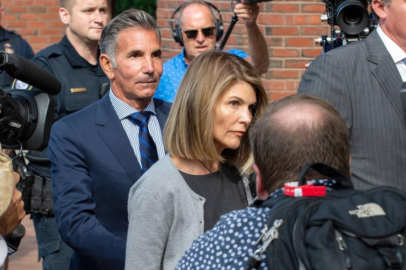 Actress Lori Loughlin and husband Mossimo Giannulli exit the Boston Federal Court house after a pre-trial hearing with Magistrate Judge Kelley at the John Joseph Moakley US Courthouse in Boston on August 27, 2019. - Loughlin and Giannulli are charged with conspiracy to commit mail and wire fraud and conspiracy to commit money laundering in the college admissions scandal. (Photo by Joseph Prezioso / AFP) (Photo credit should read JOSEPH PREZIOSO/AFP/Getty Images)