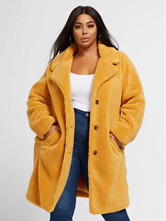 "This short yellow teddy coat has brow buttons, side pockets and oversized lapels. <strong><a href=""https://fave.co/2AhC2Jn"" target=""_blank"" rel=""noopener noreferrer"">Find it for $97 at Fashion To Figure</a>.</strong>"