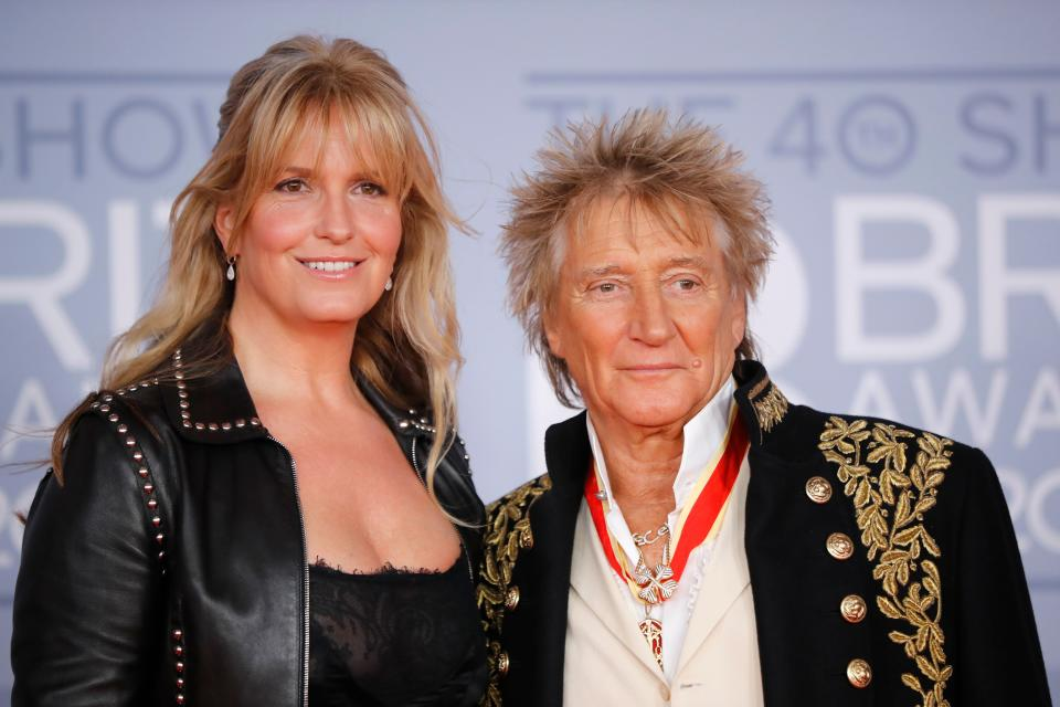 Rod Stewart (R) and his wife Penny Lancaster (L) pose on the red carpet on arrival for the BRIT Awards 2020 in London on February 18, 2020. (Photo by Tolga AKMEN / AFP)