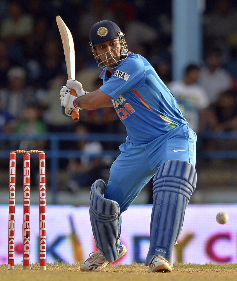 Indian cricket team captain Mahendra Sing Dhoni hits a boundary for six runs to seal their victory during the final match of the Tri-Nation series between India and Sri Lanka at the Queen's Park Oval stadium in Port of Spain on July 11, 2013. India defeated Sri Lanka by 1 wicket to win the series. AFP PHOTO/Jewel Samad        (Photo credit should read JEWEL SAMAD/AFP/Getty Images)