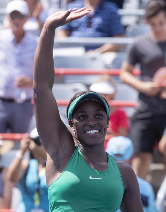 Sloane Stephens, of the Unites States, waves to the crowd following her victory over Carla Suarez Navarro, of Spain, at the Rogers Cup women's tennis tournament, Thursday Aug, 9, 2018 in Montreal. (Paul Chiasson/The Canadian Press via AP)
