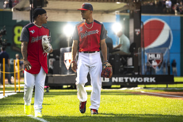 Mookie Betts #50 of the Boston Red Sox talks with Marcus Stroman #6 of the Toronto Blue Jays before the 2019 MLB All-Star Game at Progressive Field on July 9, 2019 in Cleveland, Ohio. (Photo by Billie Weiss/Boston Red Sox/Getty Images)