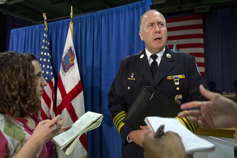 "Prince George's County, Md. Police Chief Mark Magaw answers questions at the Prince George's County Police Headquarters in Palmer Park, Md., Friday, July 27, 2012, after a news conference to discuss a suspect who police say was plotting a shooting in his workplace. A Maryland man calling himself ""a joker"" is accused of threatening to shoot up the business from which he was about to be fired and was wearing a T-shirt that read ""Guns don't kill people. I do,"" when he first talked to officers who arrested him, police said Friday. (AP Photo/Jacquelyn Martin)"