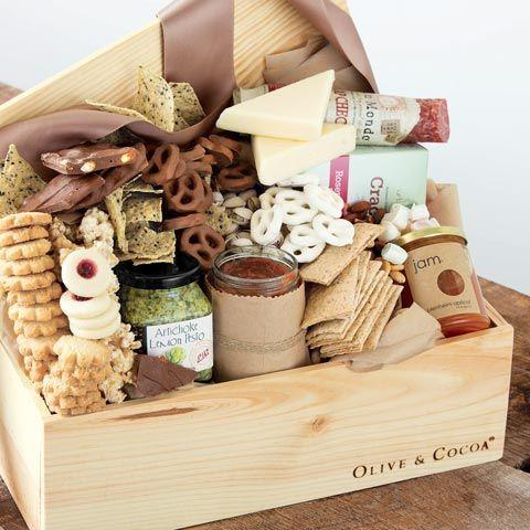 """<p>oliveandcocoa.com</p><p><strong>$144.00</strong></p><p><a href=""""https://www.oliveandcocoa.com/product/snacks-to-share/top-10-food-gifts"""" rel=""""nofollow noopener"""" target=""""_blank"""" data-ylk=""""slk:Shop Now"""" class=""""link rapid-noclick-resp"""">Shop Now</a></p><p>With cheeses, crackers, nuts, salsa, chocolate, and more, this basket totally lives up to its name. You can choose from petite, medium, and large sizes. </p>"""