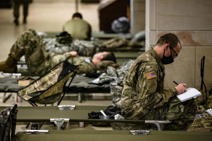 National Guard soldiers rest on cots in the Visitors Center of the U.S. Capitol on January 17, 2021 in Washington, DC.  / Credit: Samuel Corum / Getty Images
