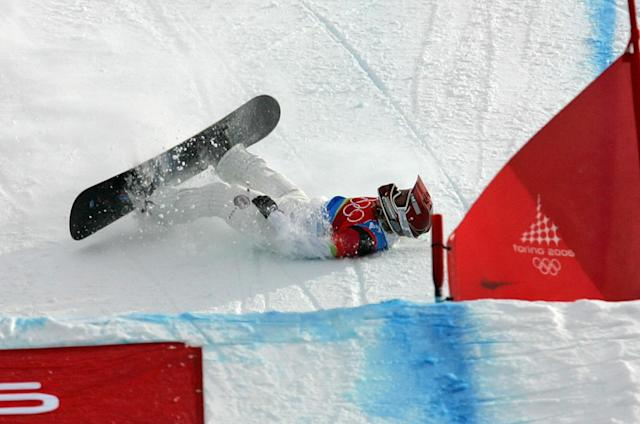 American Lindsey Jacobellis, who was leading in the final of the Women's Snowboard Cross competition, crashes in sight of the finish at the Turin 2006 Winter Olympic Games. (AP file photo)