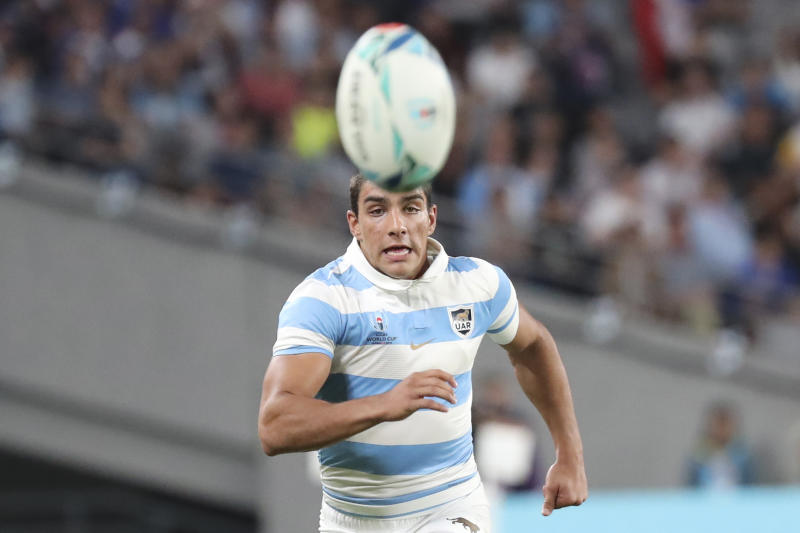 Argentina's Santiago Carreras chases a ball during the Rugby World Cup Pool C game at Tokyo Stadium between France and Argentina in Tokyo, Japan, Saturday, Sept. 21, 2019. (AP Photo/Eugene Hoshiko)