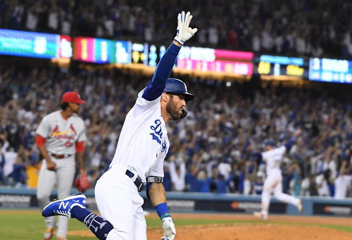 Los Angeles Dodgers left fielder Chris Taylor celebrates while rounding the bases