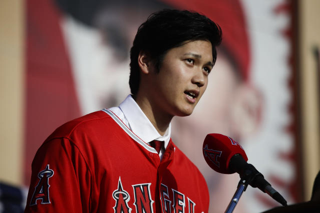 Collectors made sure to get their hands on Shohei Ohtani's first MLB card. (AP Photo/Jae C. Hong)