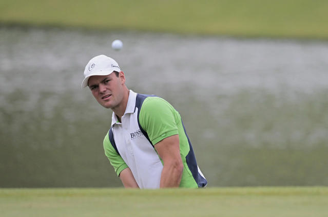 Martin Kaymer of Germany chips onto the 9th hole during the first round of the Shanghai HSBC Champions golf tournament at the Sheshan International Golf Club in Shanghai, China, Thursday, Oct. 31, 2013. (AP Photo)
