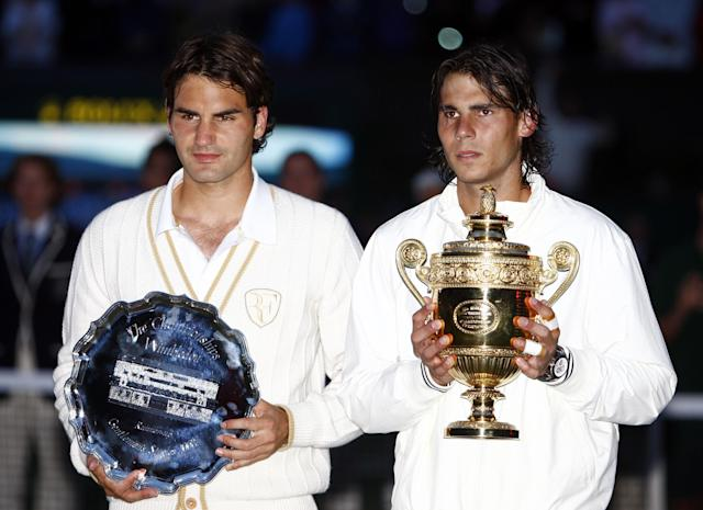 Rafael Nadal and Roger Federer pose with their trophies. (Sean Dempsey/PA Images via Getty)