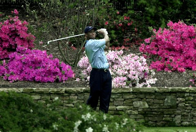 <p>Tiger Woods watches his tee shot on the 13th hole during third round play of the 2002 Masters Saturday, April 13, 2002, at the Augusta National Golf Club in Augusta, Ga. (AP Photo/Chris O'Meara) </p>