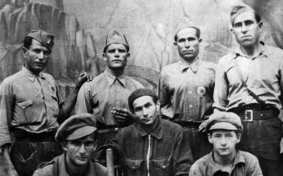 Pierre Georges aka Colonel Fabien (bottom right) in July 1937 in Spain with members of the International Brigades - Getty