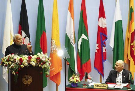 India's PM Modi speaks as Afghanistan's President Ghani watches during the opening session of 18th SAARC summit in Kathmandu