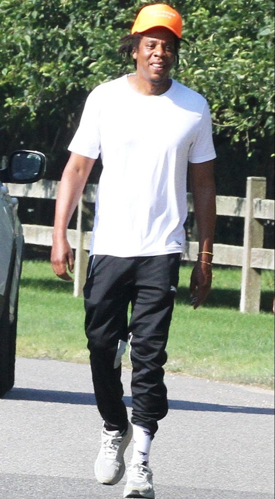 <p>JAY-Z takes a walk through The Hamptons, New York, wearing a white tee and track pants on Wednesday.</p>