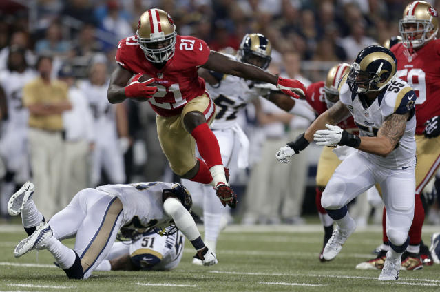 San Francisco 49ers running back Frank Gore (21) runs with the ball for an 18-yard gain during the first quarter of an NFL football game as St. Louis Rams linebacker James Laurinaitis, right, gives chase Thursday, Sept. 26, 2013, in St. Louis. (AP Photo/Charlie Riedel)