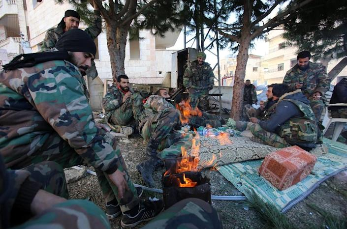 Pro-government fighters relax in Salma in Syria's Latakia province on January 15, 2016 following its recapture from rebels (AFP Photo/Youssef Karwashan)