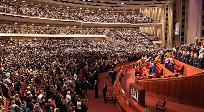 People gather inside the Conference Center during the 184th Annual General Conference of The Church of Jesus Christ of Latter-day Saints Saturday, April 5, 2014, in Salt Lake City. More than 100,000 Latter-day Saints are expected in Salt Lake City this weekend for the church's biannual general conference. Leaders of The Church of Jesus Christ of Latter-day Saints give carefully crafted speeches aimed at providing members with guidance and inspiration in five sessions that span Saturday and Sunday. They also make announcements about church statistics, new temples or initiatives. In addition to those filling up the 21,000-seat conference center during the sessions, thousands more listen or watch around the world in 95 languages on television, radio, satellite and Internet broadcasts. (AP Photo/Rick Bowmer)