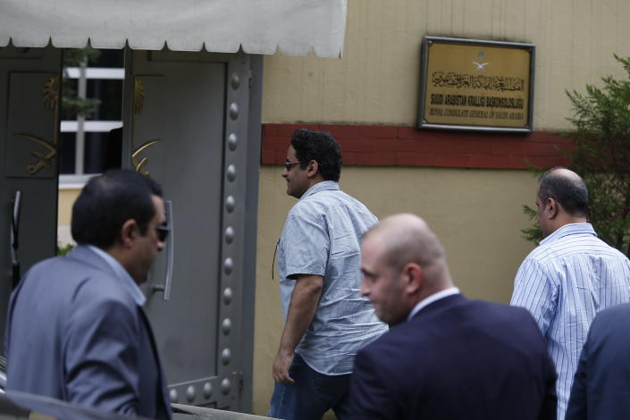 Staff arrive at the Saudi Arabia consulate in Istanbul, Tuesday, Oct. 9, 2018. Turkey said Tuesday it will search the Saudi Consulate in Istanbul as part of an investigation into the disappearance of Jamal Khashoggi, a missing Saudi contributor to The Washington Post, a week after he vanished during a visit there. (AP Photo/Lefteris Pitarakis)