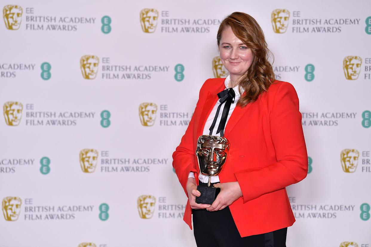 Hair and makeup designer Nadia Stacey pose with the award for Production Design for her work on the film 'The Favourite' at the BAFTA British Academy Film Awards at the Royal Albert Hall in London on February 10, 2019. (Photo by Ben STANSALL / AFP)        (Photo credit should read BEN STANSALL/AFP via Getty Images)